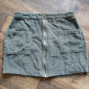 Olive colored zip front mini skirt size M
